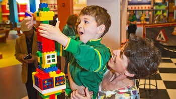 Show item 3 of 5. Child playing with Legos