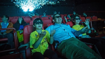 Show item 5 of 5. Families watching a 3D movie at Legoland
