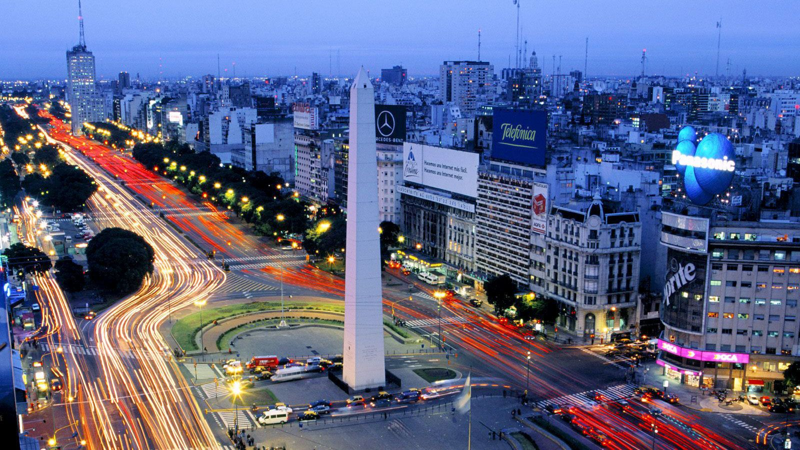 city lights around a standing monument in Argentina