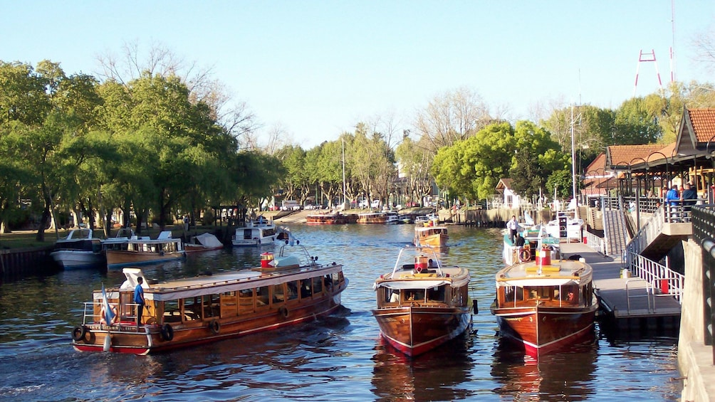 three small boats along the channel in Argentina