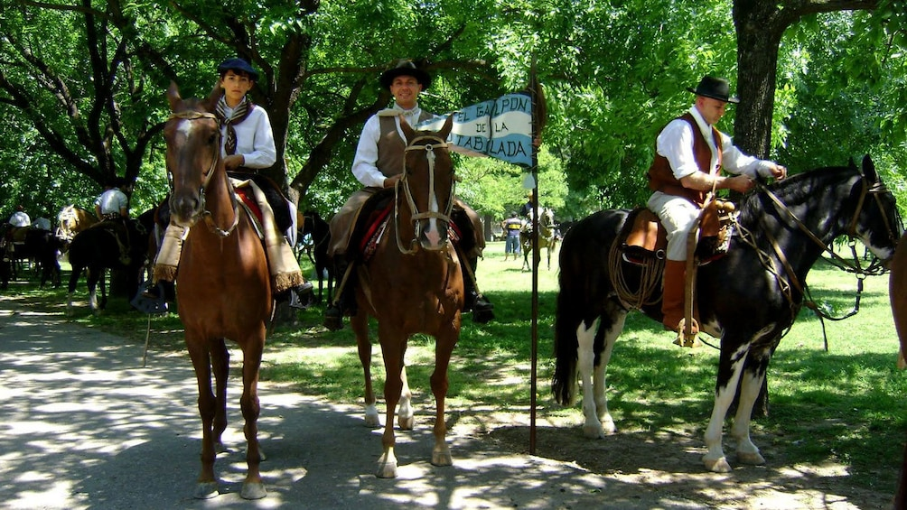 group in colonial costumes riding horses in Argentina