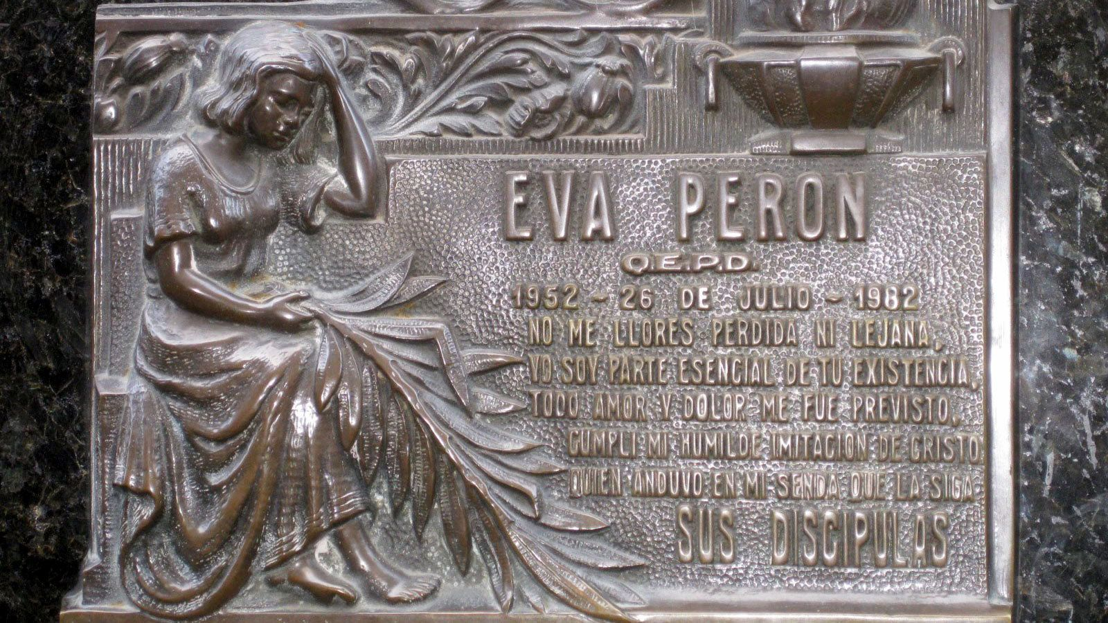 a plaque of Evita Peron on the wall in Argentina