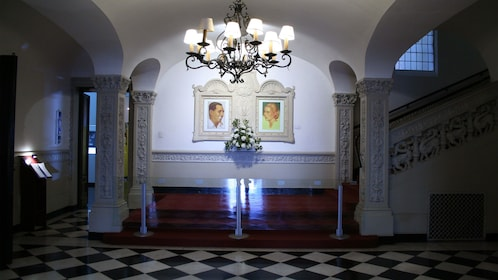 Paintings of Evita and Juan Peron in the great halls of a building in Argentina