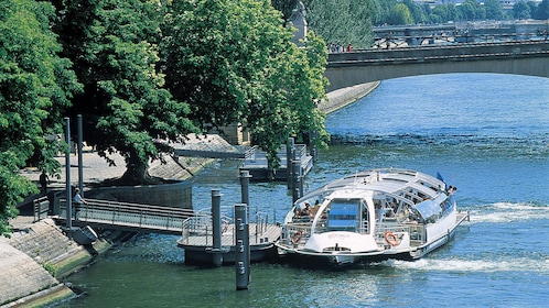 Batobus docked on the Seine river.