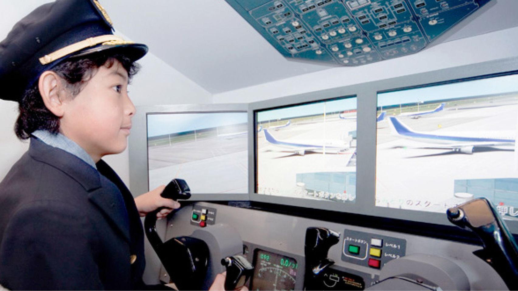 Young boy learning about being a pilot at the Kidzania in London