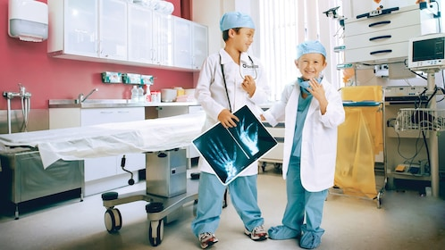 Two young boys in doctors' outfits at the Kidzania in London