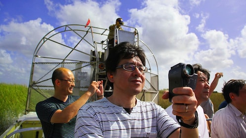 man recording his adventure on a boat in Miami