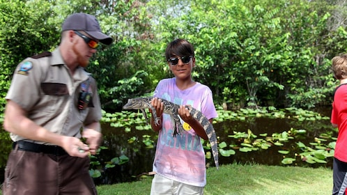 boy holding a small alligator in Miami