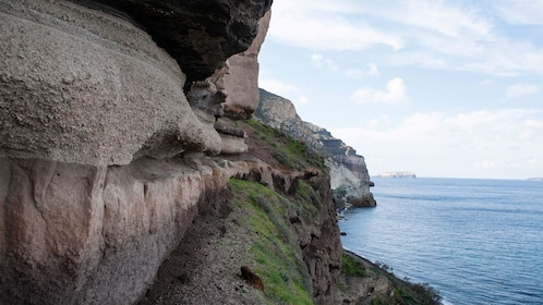 the steep and rocky cliffs at the coastline in Greec