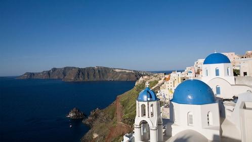 white buildings along the steep coastline in Greece