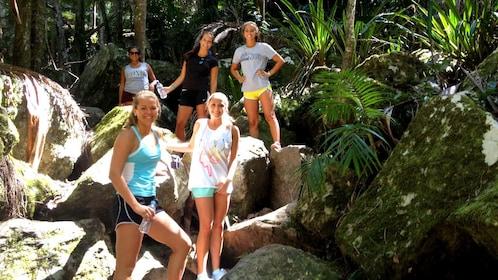 Girls hiking down a boulder path in Australia