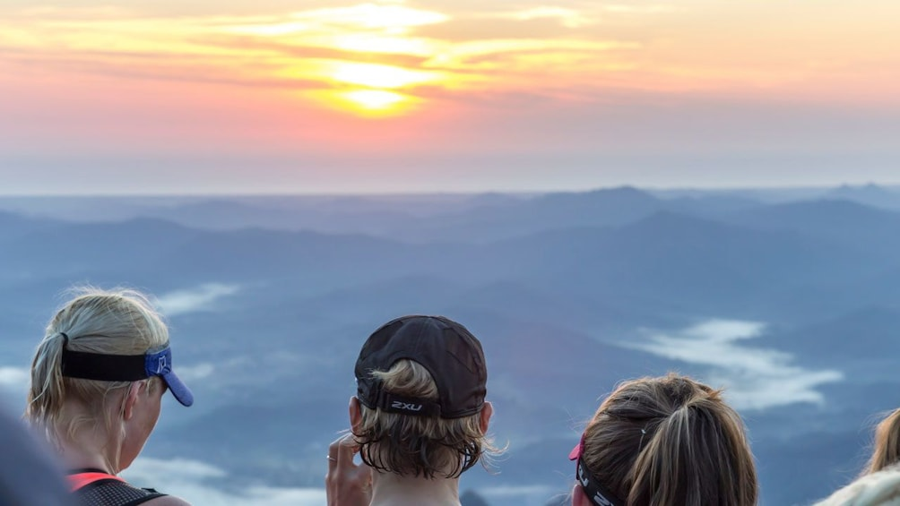 Show item 5 of 5. hikers spectating the sunset from top of the mountain in Australia