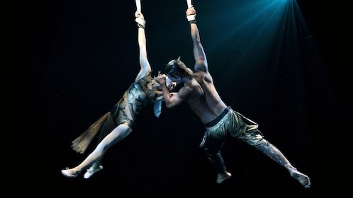 Acrobatic perfomers suspended by silks during the Devdan Show in Bali