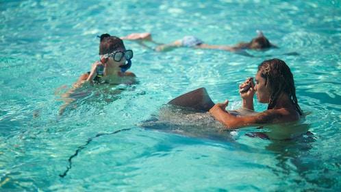 Guests snorkeling in the beautiful waters of Bora Bora