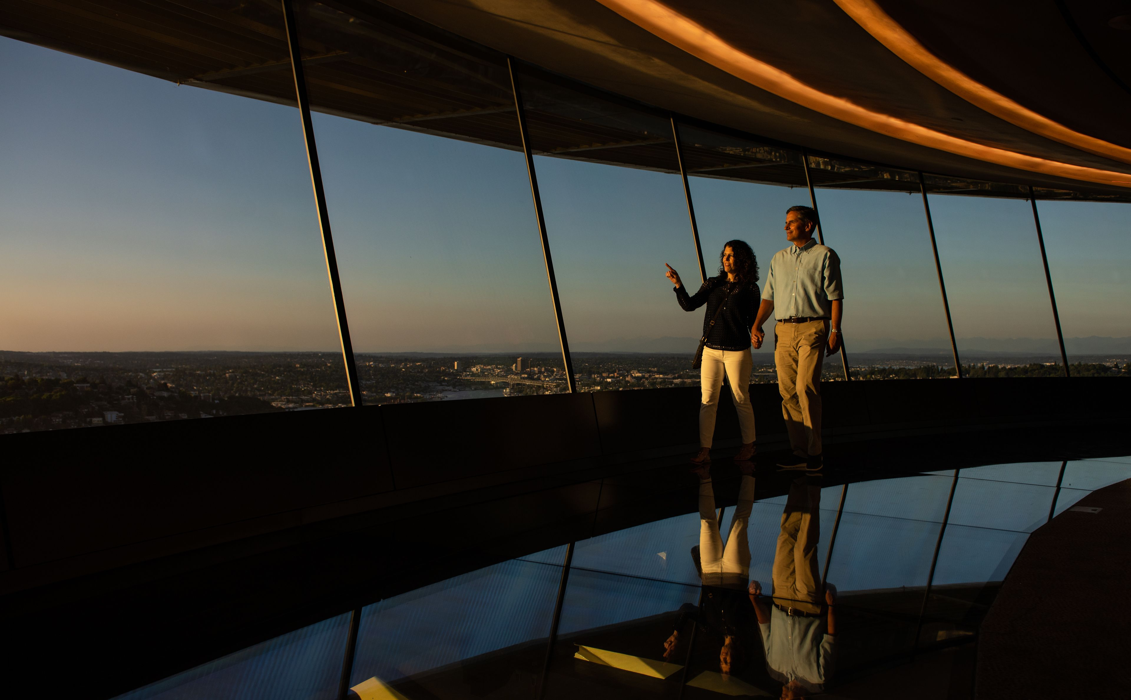 Walking on the world's first revolving glass floor at The Loupe. Courtesy of Space Needle and Rod Mar.jpg