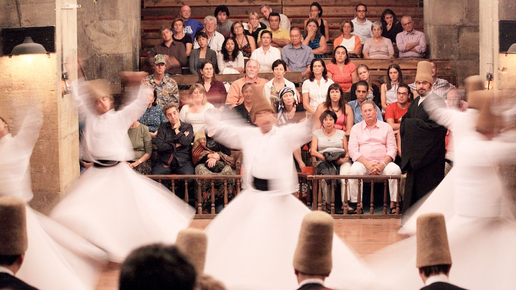 Charger l'élément 4 sur 5. Guests enjoying the Whirling Dervishes Show in Cappadocia