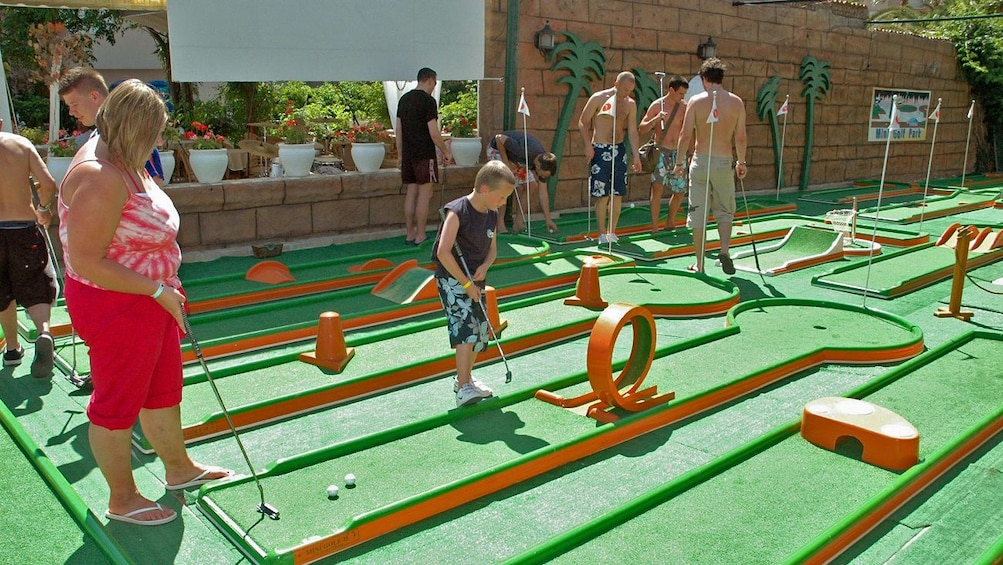 Show item 3 of 5. People on mini golf course