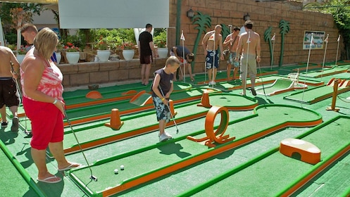 People on mini golf course
