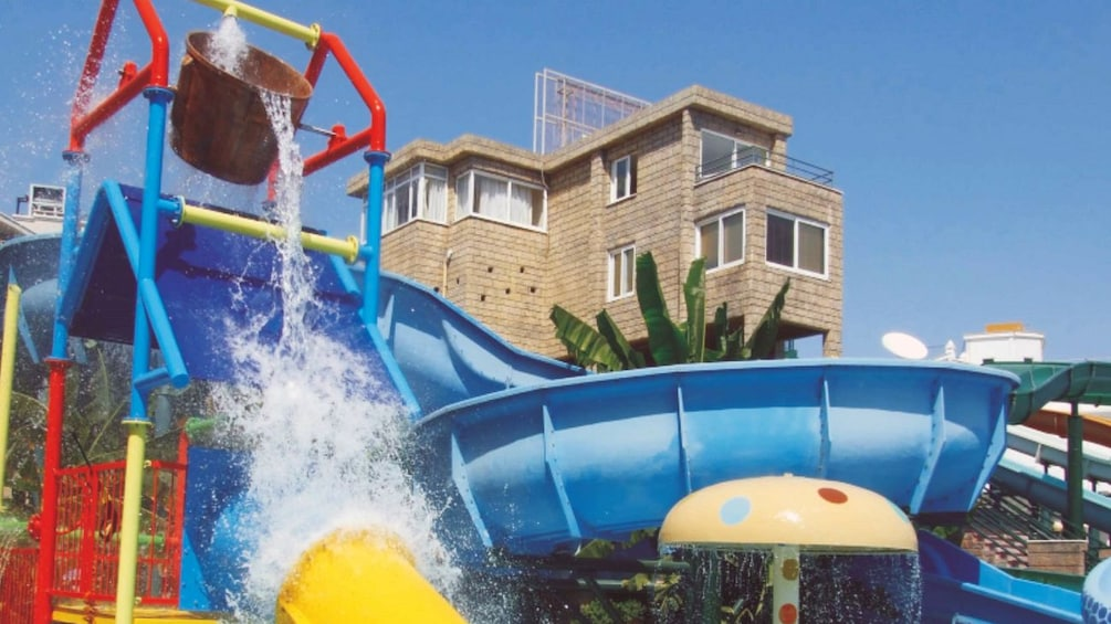 Show item 5 of 5. water slide with torrent of water from bucket