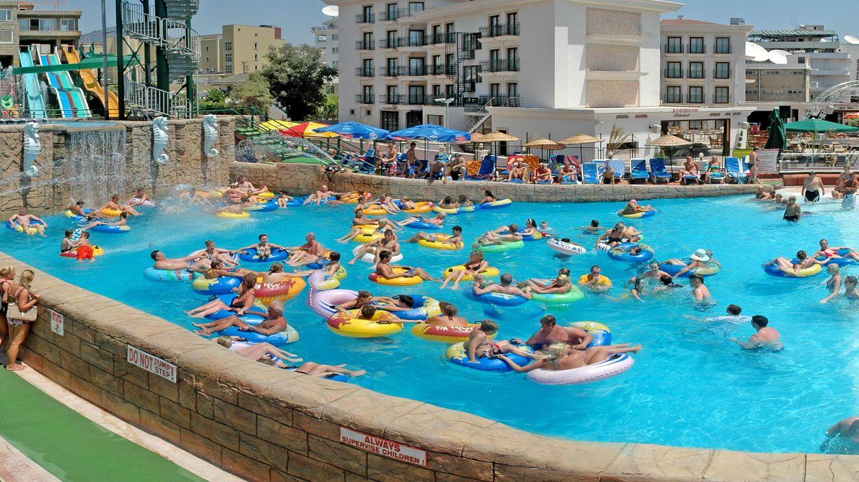 floating pool full of people in inner tubes