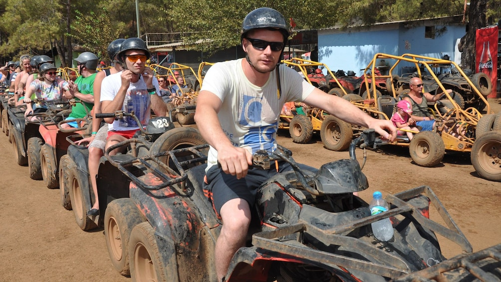 Show item 1 of 5. group of ATV riders ready to go