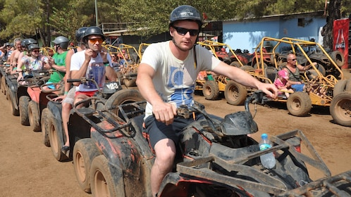 group of ATV riders ready to go