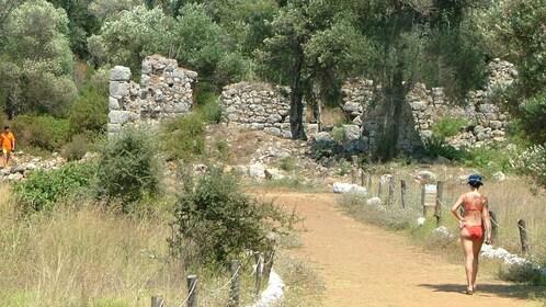 woman walking toward ruins