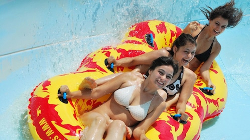 girls on triplet waterslide tube