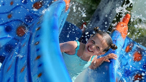 girl smiling on waterslide