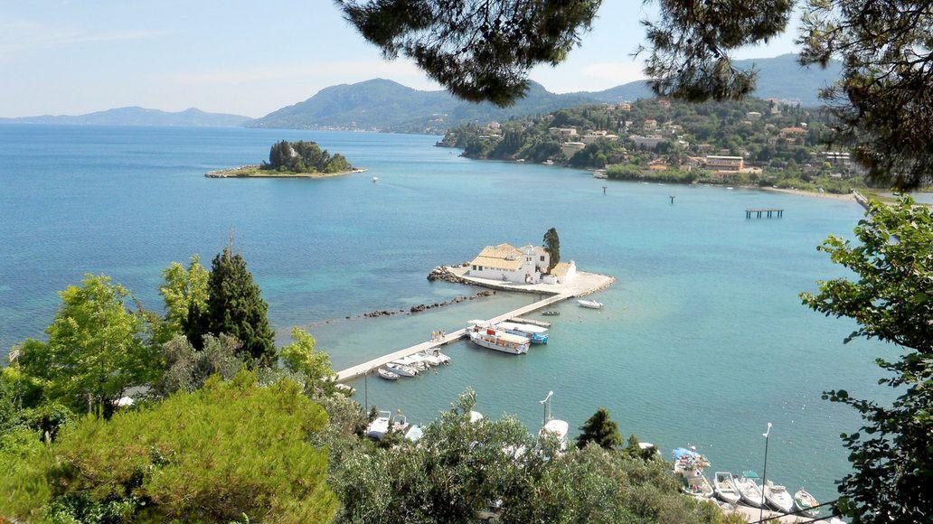 Vlacherna Monastery on the water with a small island nearby on Corfu