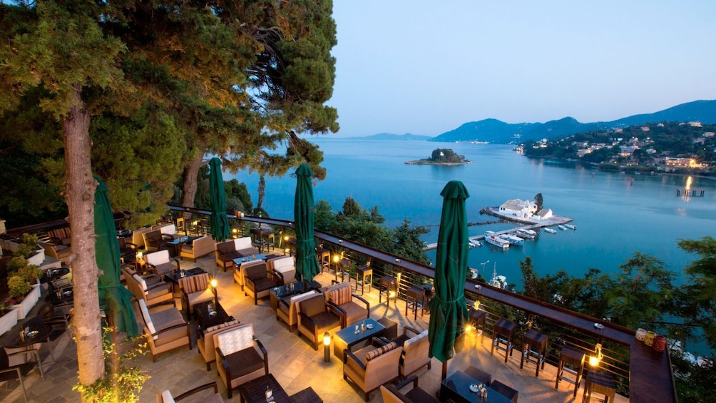 Show item 5 of 5. Outside dining overlooking the water on Corfu