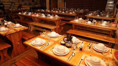 large dining tables set with dinnerware