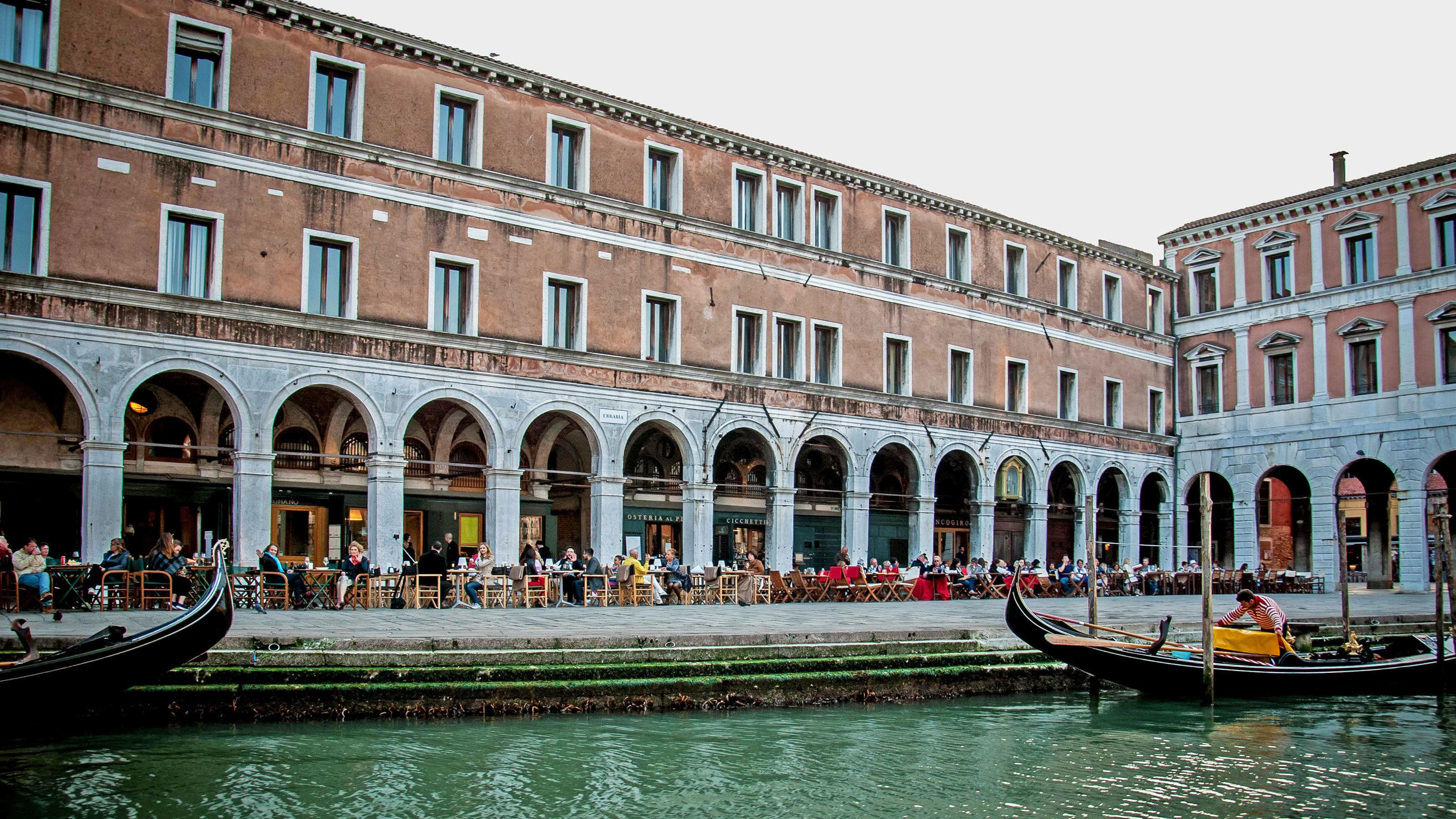 buildings lining canal in venice