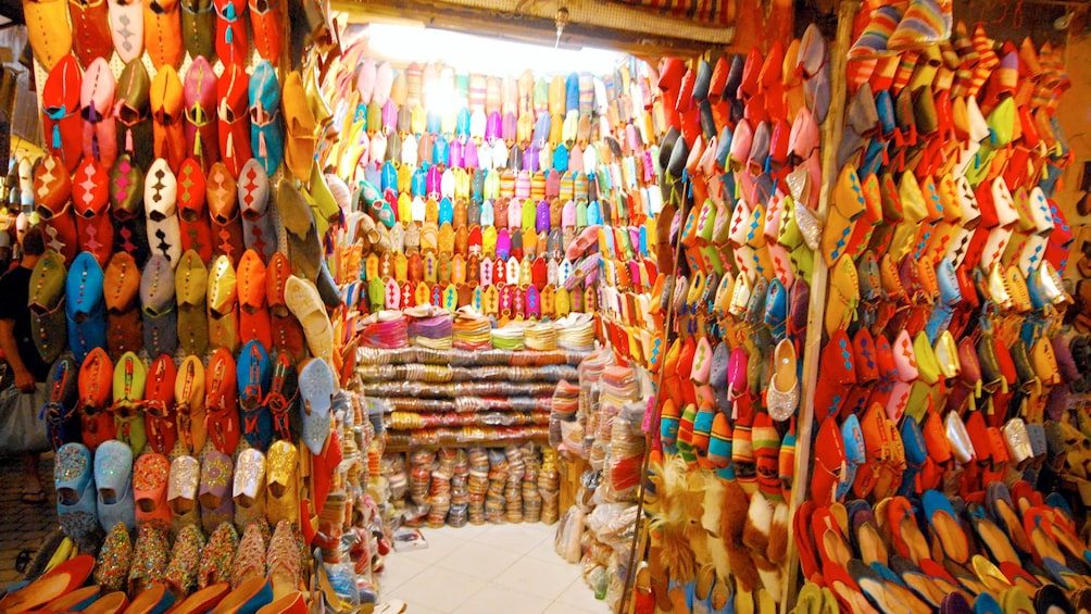 Show item 5 of 5. Colorful handmade shoes at a market in Marrakech