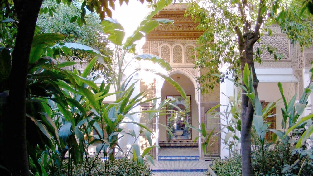 Show item 3 of 5. Gardens and mosaic walkway at a palace in Marrakech