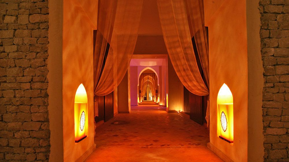candle lit hallway at the spa in Morocco