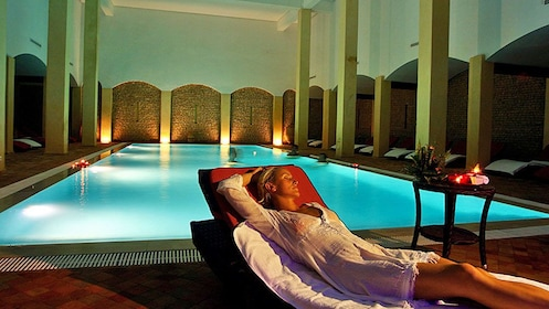woman relaxing by the pool at the spa in Morocco