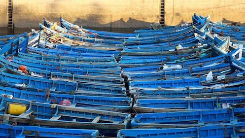 Rows of blue wooden boats in Essaouira