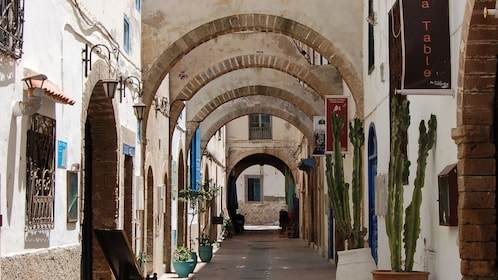 Archways over a narrow street in Essaouira