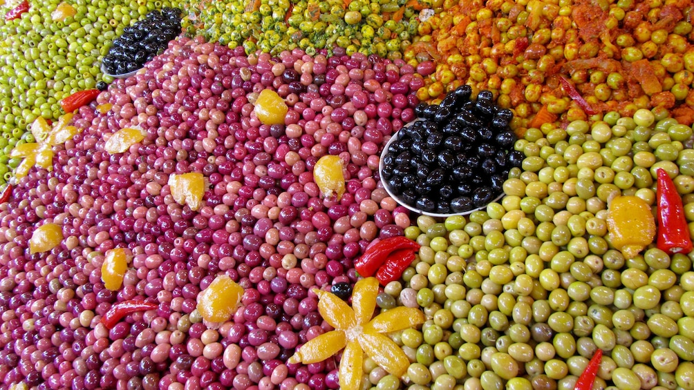Show item 5 of 5. Array of olives on display at a market in Agadir