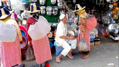 Locals haggling with a street vendor in Marrakech