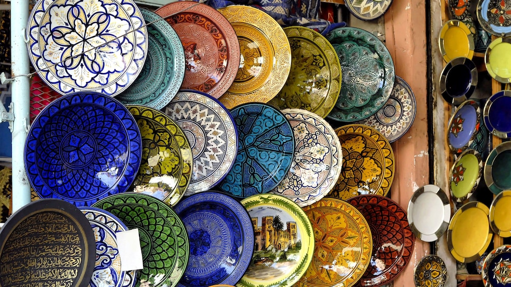 Show item 4 of 5. Colorful pottery for sale at a market in Agadir