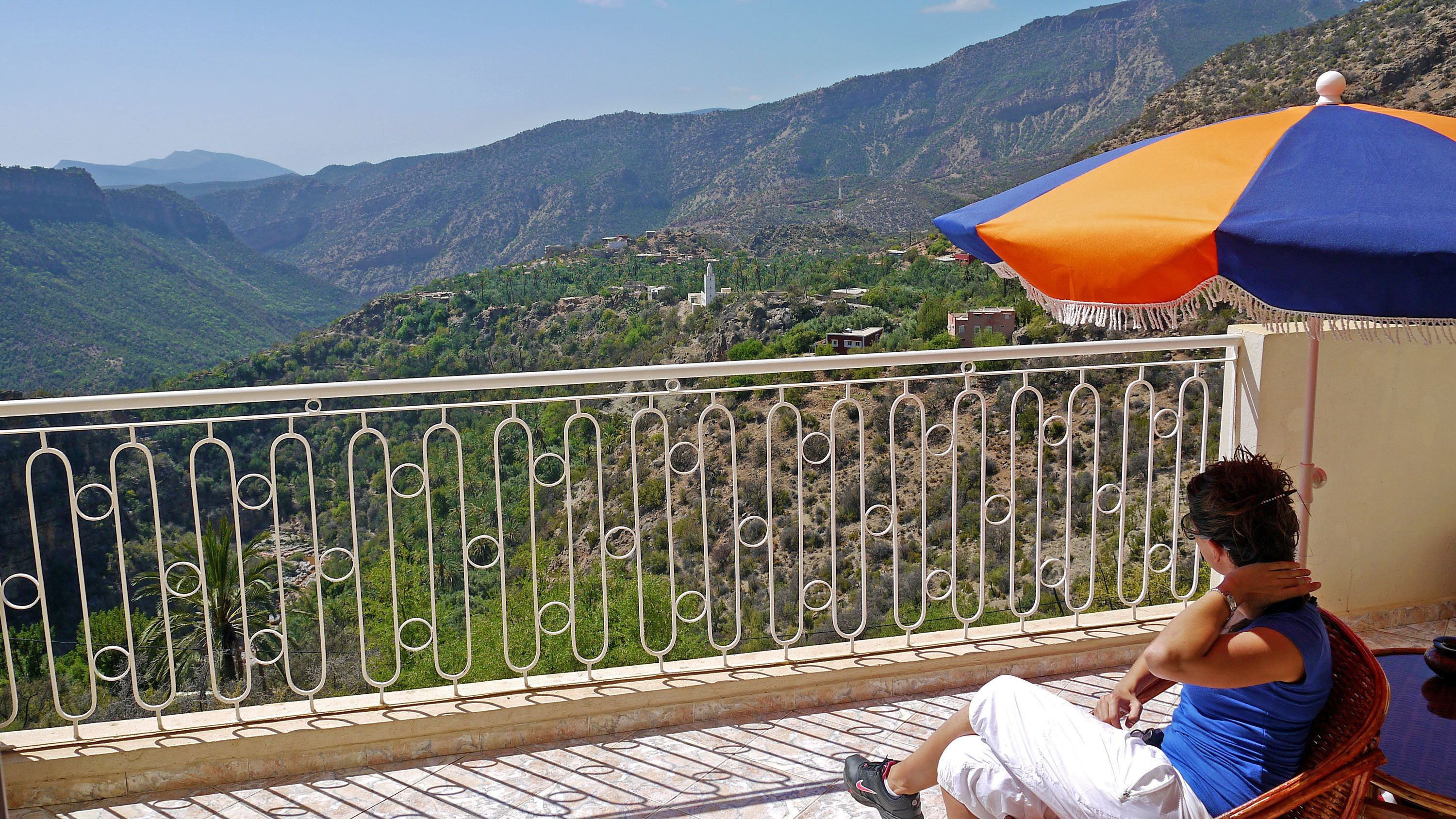 Woman on a balcony enjoying a panoramic view of Paradise Valley