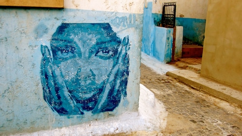 face painted on wall in blue