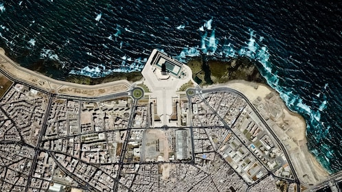 direct aerial view of city and coast