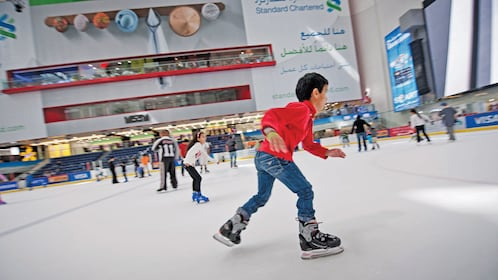 boy in red sweater ice skating