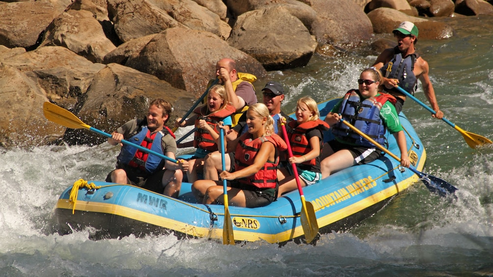 Show item 1 of 5. River rafting group in Colorado