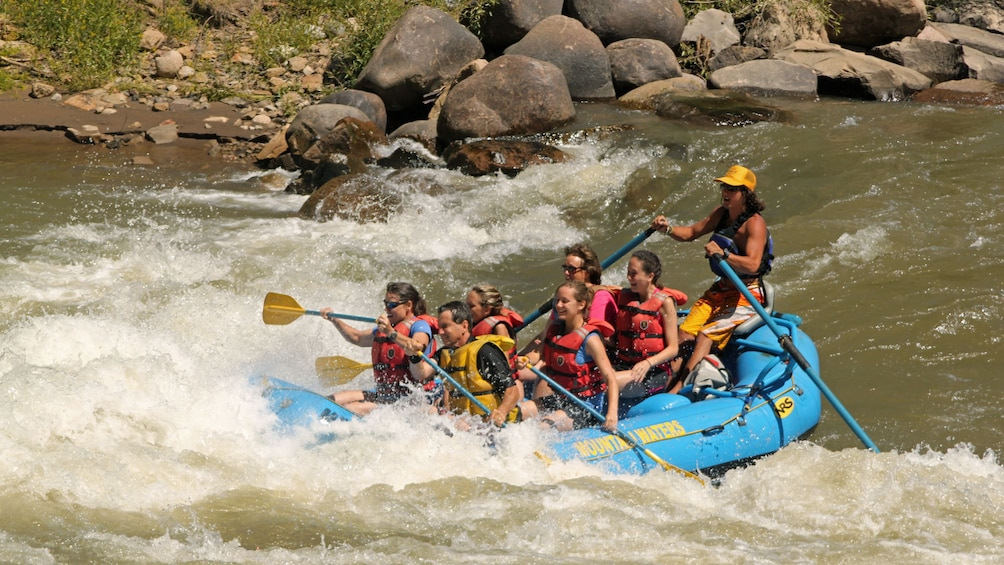 Show item 3 of 5. River rafting group in Colorado