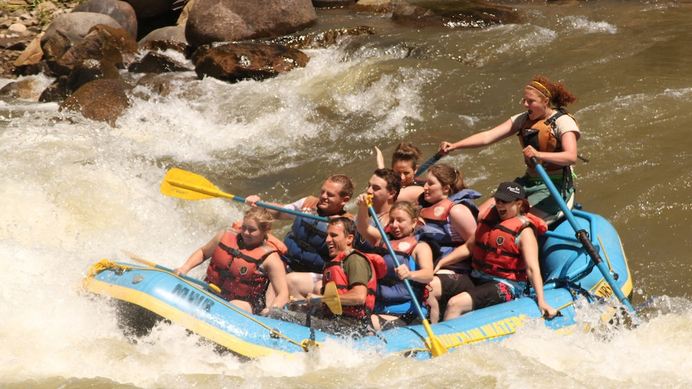 Show item 5 of 5. River rafting group in Colorado