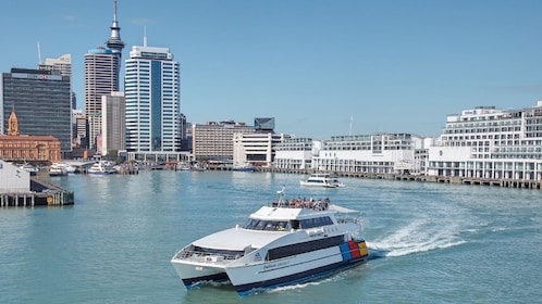 loaded cruise departing the Auckland Harbor in New Zealand